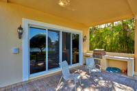 19008 SE Windward Island exterior patio view 2